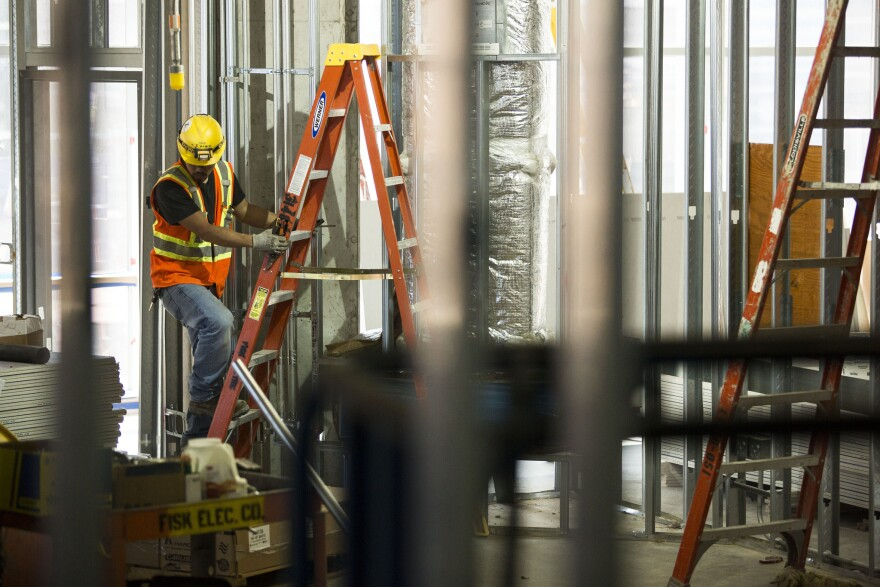 Construction workers at a building site at the Texas Medical Center in downtown Houston.