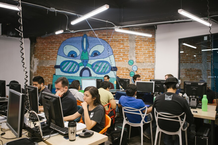 Students work on their final thesis at Hola Code on May 13. Hola Code is a software engineering program focused on integrating former migrants who returned or were deported to Mexico.