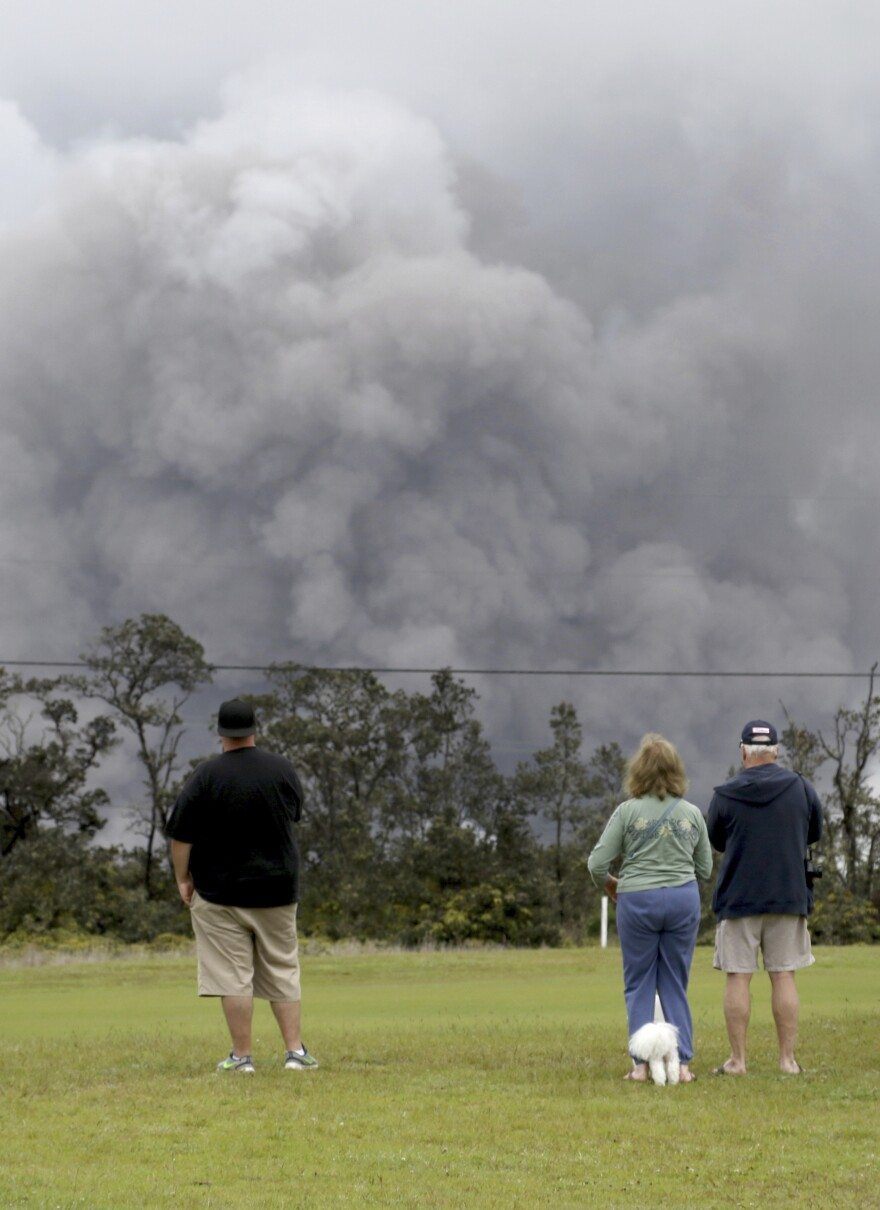 People watch as ash rises from the summit crater of Hawaii's Kilauea volcano on Thursday.