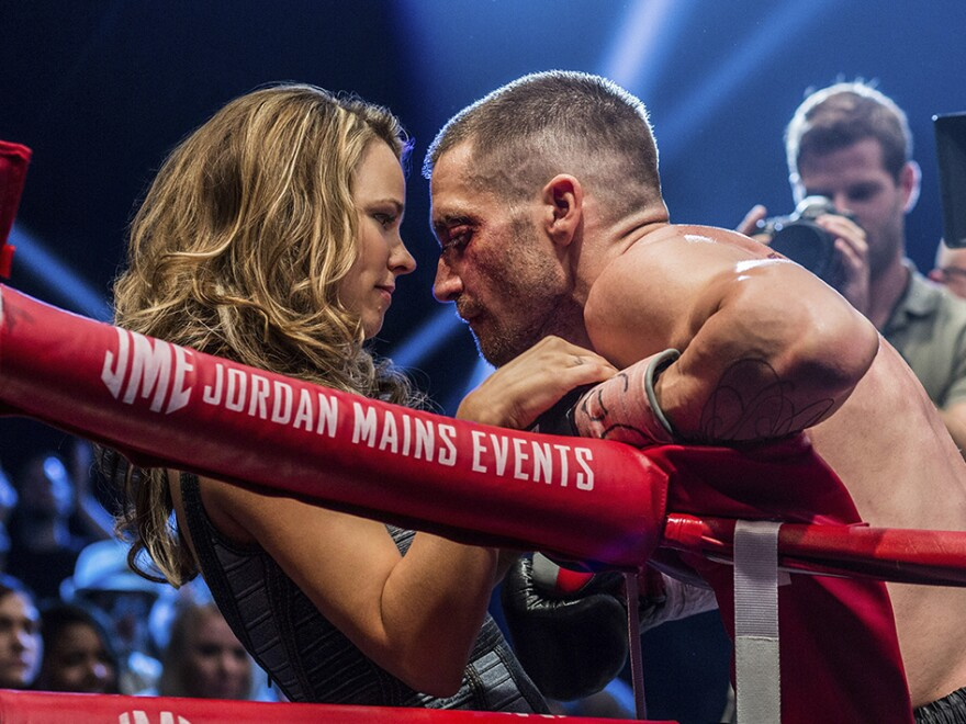 Maureen Hope (Rachel McAdams) confers with her husband Billy (Gyllenhaal) in <em>Southpaw</em>.