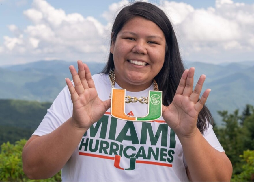 Kelsey Jackson poses with University of Miami chain