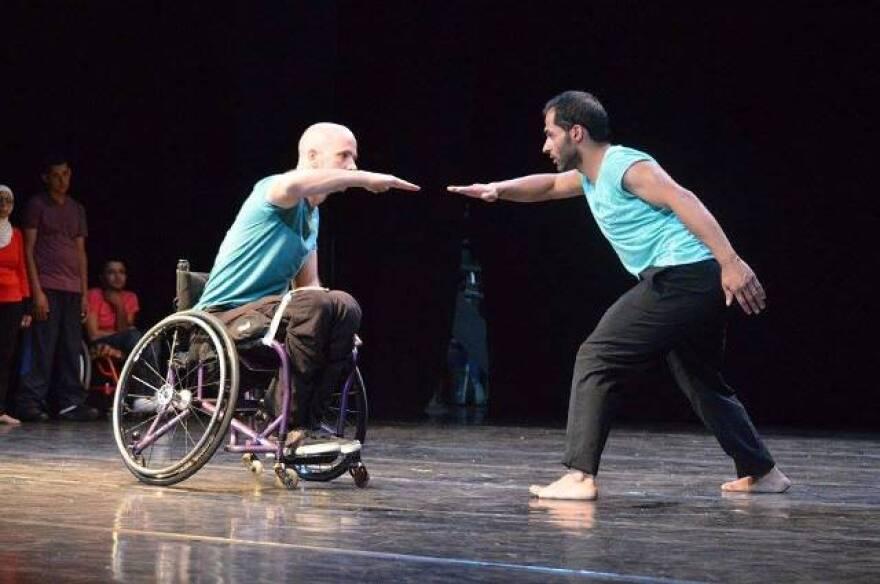 Dwayne Scheuneman (l) performs w/Palestinian dancer Adel Mashriky