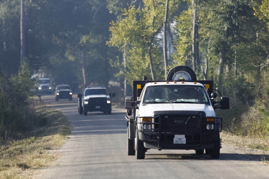 Firefighters head northbound on Alum Creek Road towards a fire near the road Thursday morning.