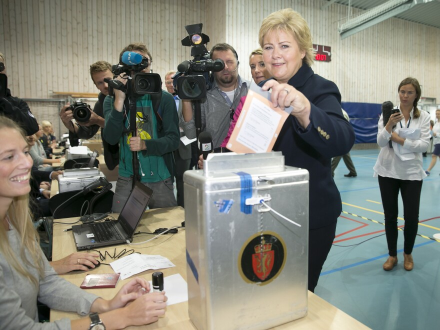 During the 2013 elections, online voting was an option in Norway. Even so, Erna Solberg, chairman of the Conservative Party of Norway, casts an old-school ballot.