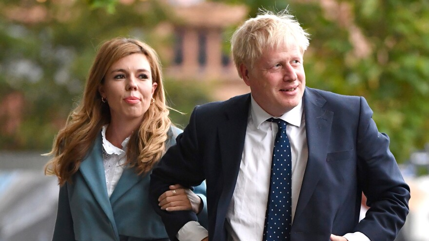 British Prime Minister Boris Johnson and his girlfriend Carrie Symonds at the Conservative Party Conference in 2019. The couple are engaged and expecting their first child.
