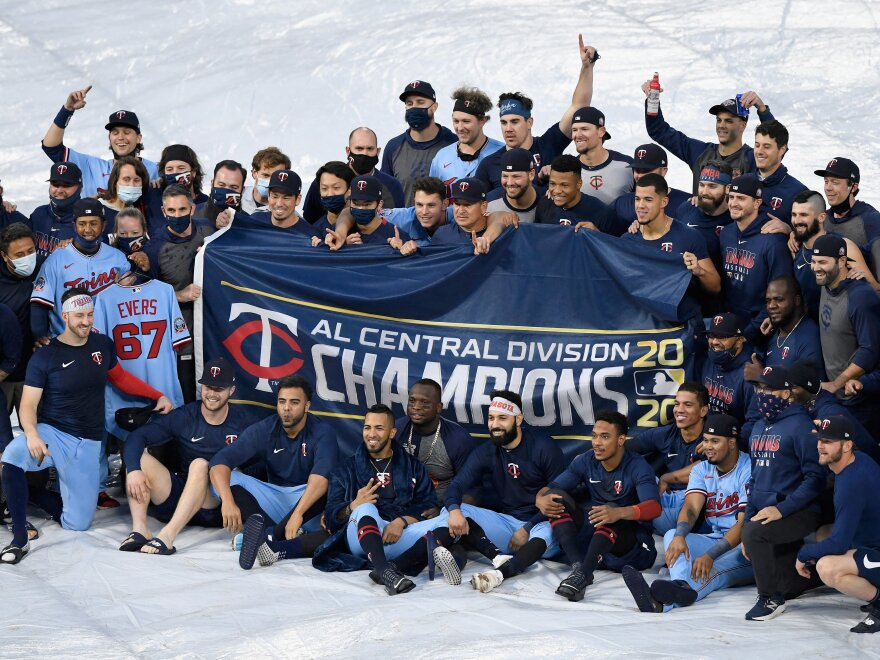 The Minnesota Twins celebrate being the American League Central Division champions after the game against the Cincinnati Reds on Sunday in Minneapolis.