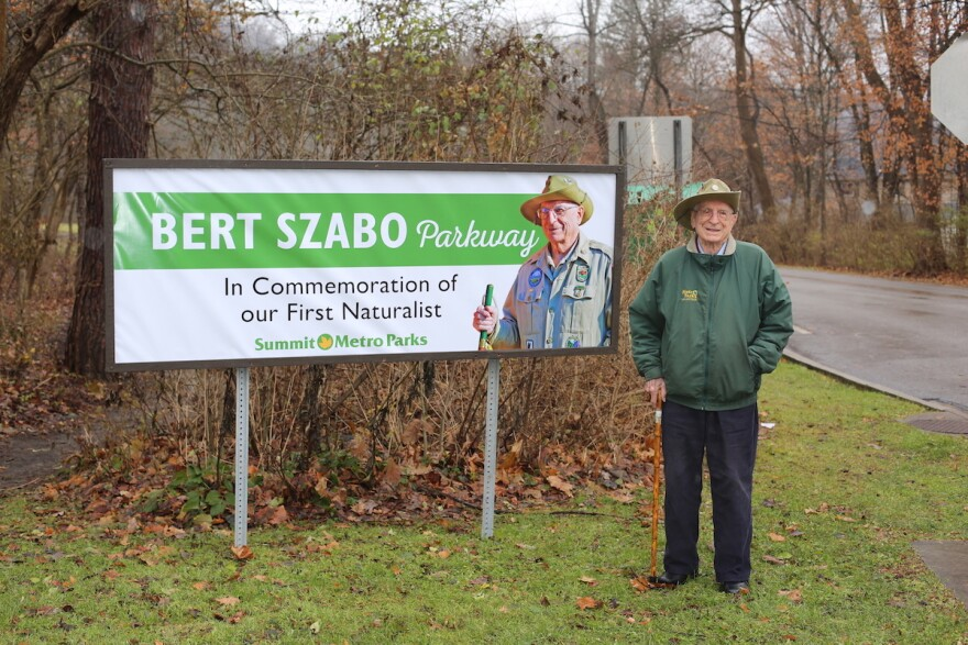 Bert Szabo with sign for Summit Metro Parks