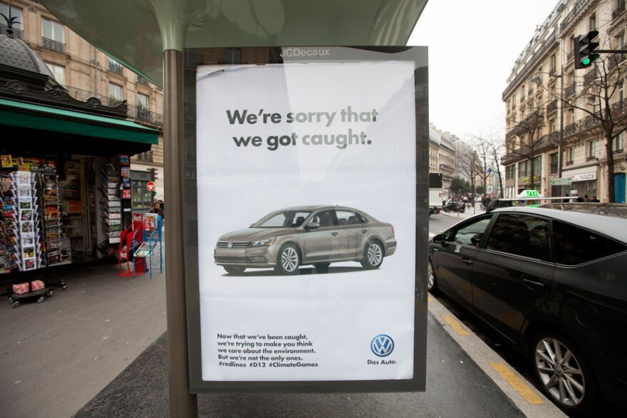 This poster references a Volkswagen scheme to defeat government emissions standards.