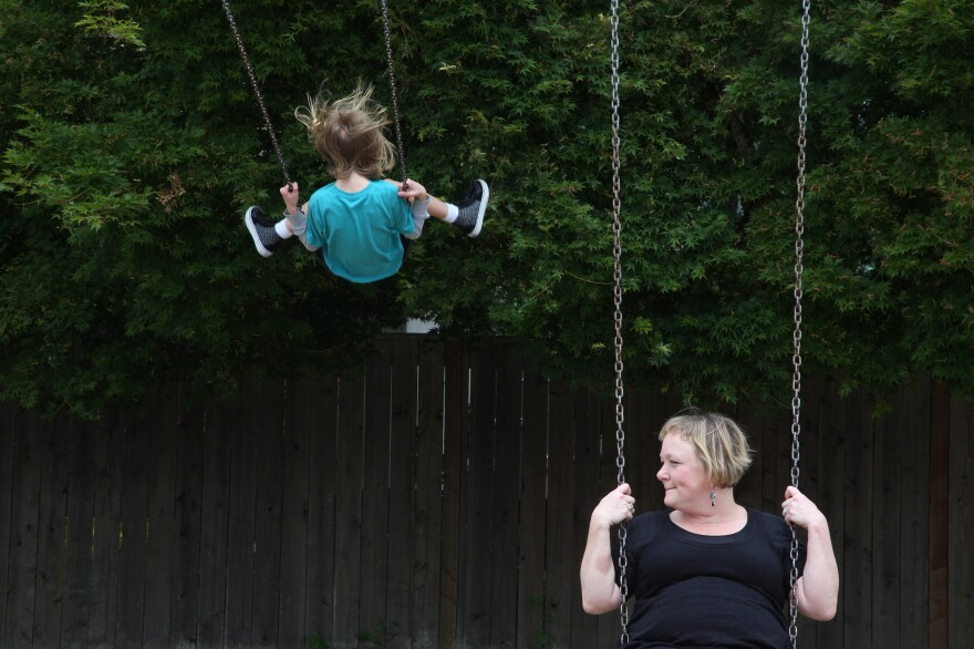 Staci Moritz and her son Aidan, 11, play at a park in their neighborhood in Portland, Ore. Caring for three children and her injured husband exacerbated her health problems.