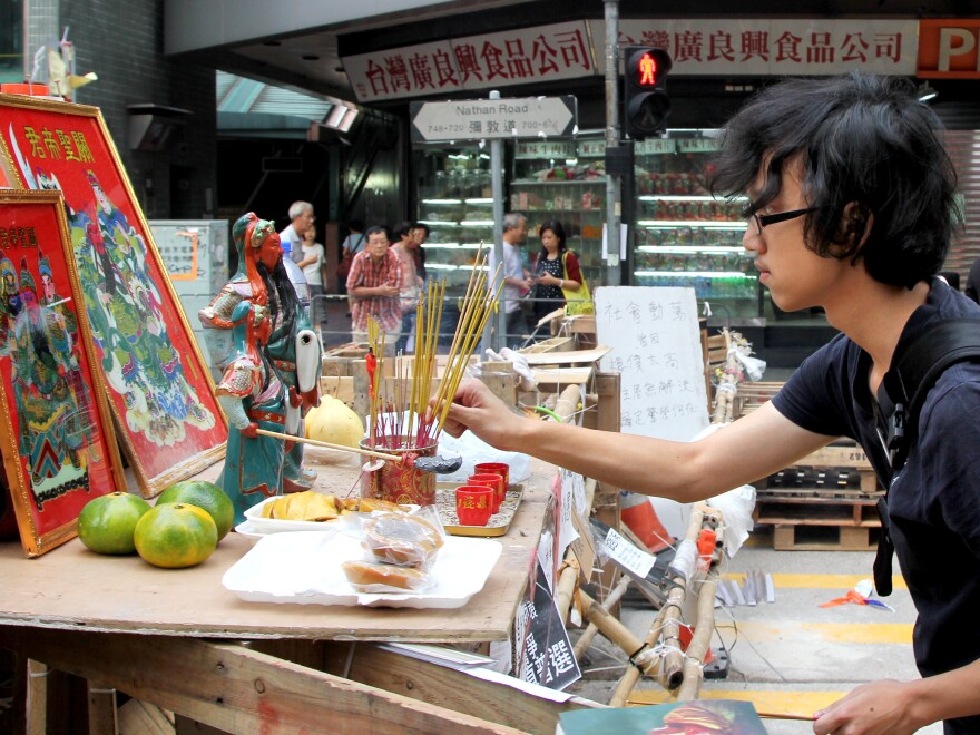 Protesters in Hong Kong's Mong Kok neighborhood erected a shrine to an ancient Chinese general to protect them from police, who fired tear gas at them last week, and gangsters, who beat them.