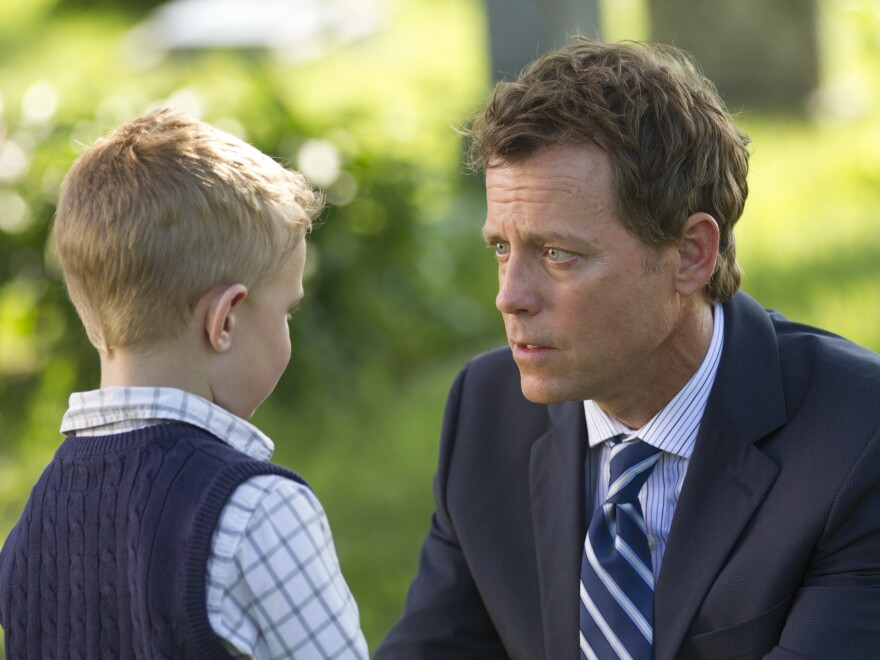 Colton Burpo (Connor Corum) tells Todd (Greg Kinnear) about heaven in <em>Heaven Is for Real</em>.