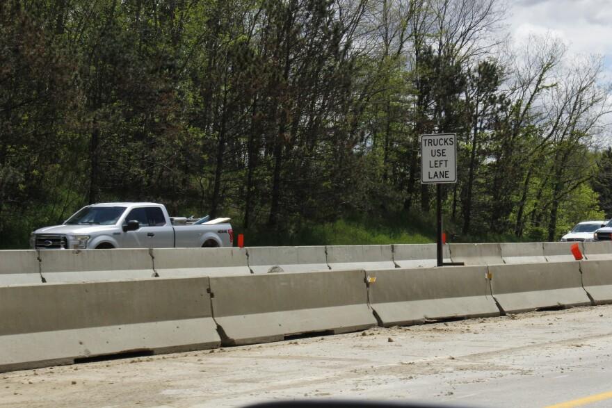 trucks use left lane sign