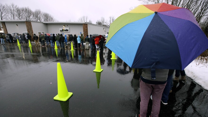 The rain didn't stop customers from lining up outside Cultivate in Leicester, Mass., on Tuesday — the first day that sales of recreational marijuana became legal in the state.