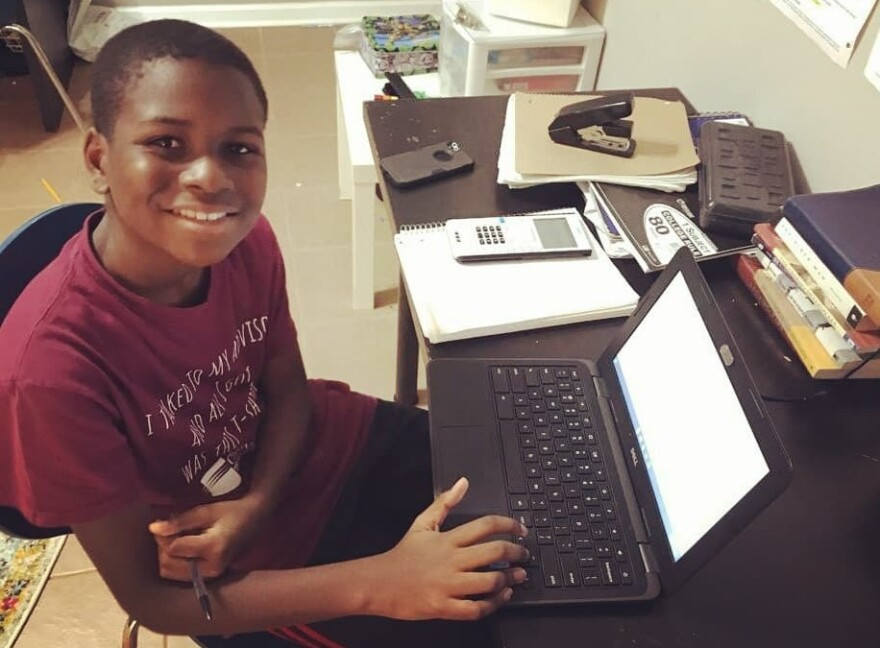 Caleb Anderson, 12, attends virtual calculus class earlier this month at Chattahoochee Technical College in Marietta, Ga., where he is a sophomore.