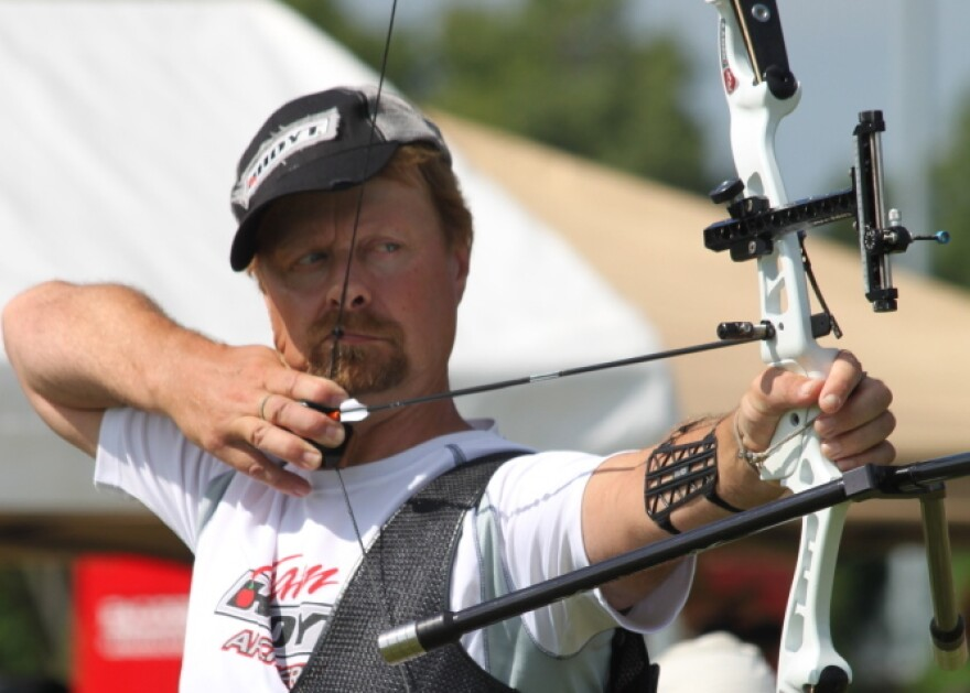 Butch Johnson competes in the 2010 U.S. National Target Championships in Hamilton, Ohio. Johnson is trying for his sixth Olympic Games this summer. When not competing, he manages an archery range in Connecticut. He keeps his Olympic medals under the kitchen sink.