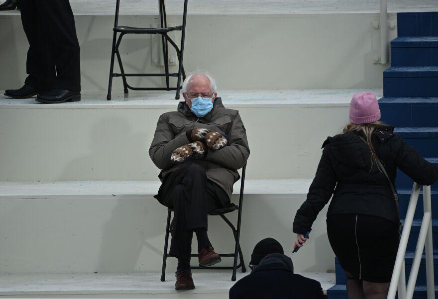 Sen. Bernie Sanders sits in the bleachers on Capitol Hill before Joe Biden is sworn in as the 46th president.
