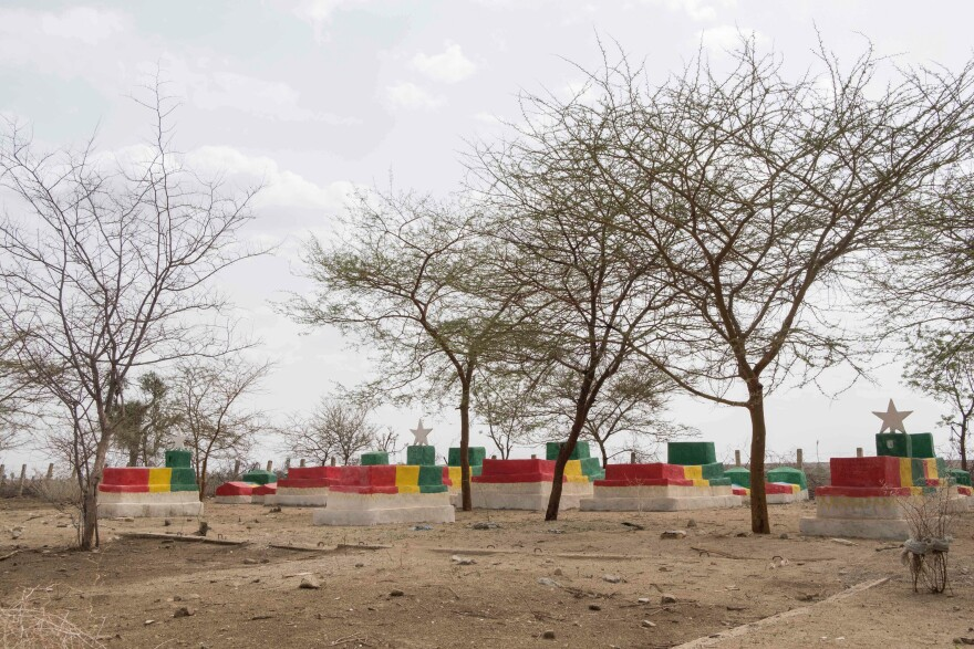 Graves of Ethiopian soldiers who died during the battle against Eritrea are painted in the colors of the Ethiopian flag in Badme, a town the Ethiopian leader has agreed to hand over to neighboring Eritrea.
