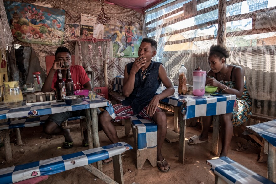 People eat lunch in a small restaurant owned by vanilla farmer Beny Odon in Belambo, Madagascar.