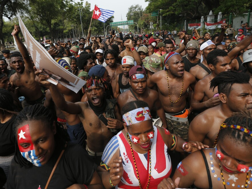 Papuan students rally near the presidential palace in Jakarta, Indonesia, on Wednesday. A group of West Papuan students in Indonesia's capital staged the protest against racism and called for independence for their region.