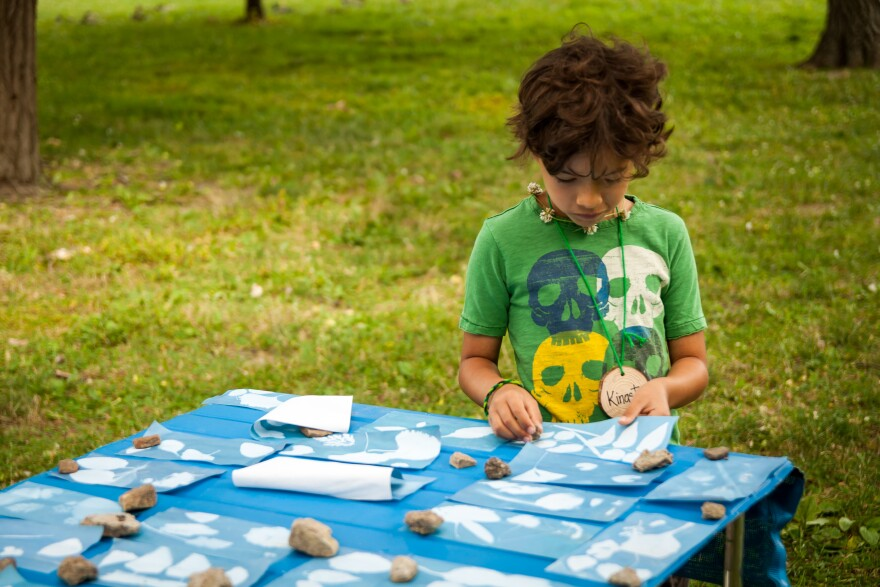 A child checks on an art project during a summer camp at Forest Park June 28, 2017.