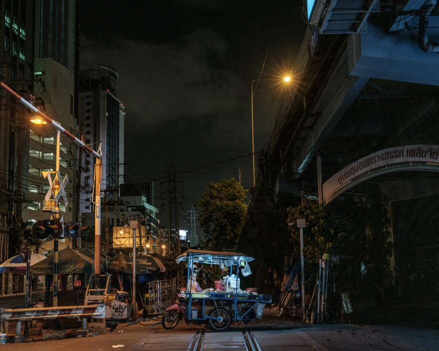 "One of Bangkok's street vendors and his bicycle worker. So-called ""informal workers"" have suffered the loss of income in the wake of coronavirus lockdown measures."