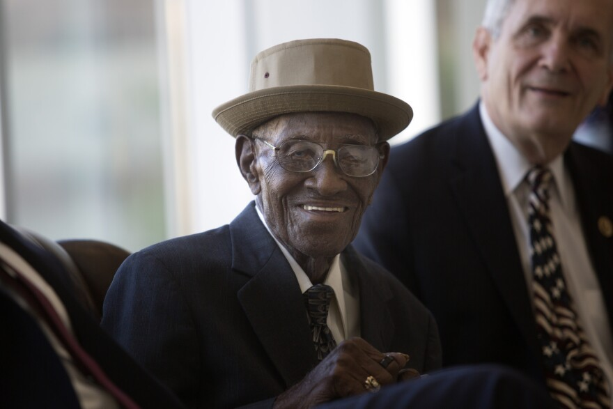 World War II veteran Richard Overton smiles during a ceremony to name a healing garden after him at the Austin VA Outpatient Clinic in April.