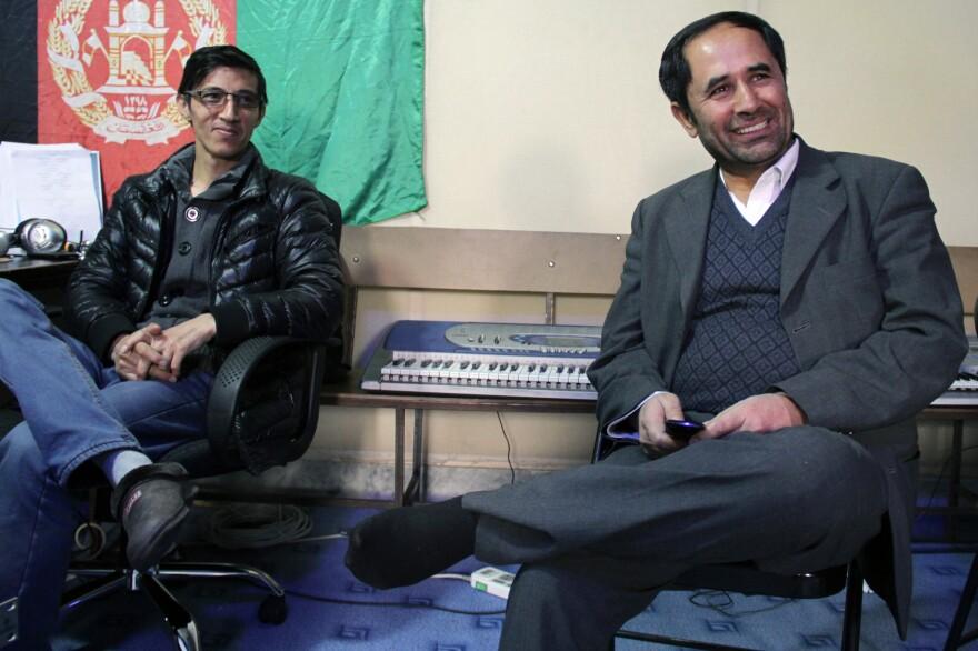 Royesh (right) visits music class.