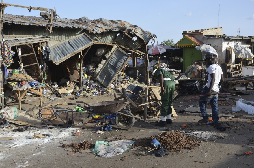 People gather at the site of a suicide bomb attack at a market in June 2015 in Maiduguri, Nigeria, where two girls blew themselves up near a crowded mosque.
