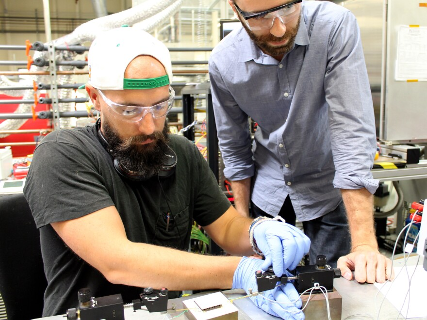 Jordan Chase (left), Alphabet Energy's lead engineer, and CEO Matt Scullin measure PowerCard properties in the company's lab in Hayward, Calif.