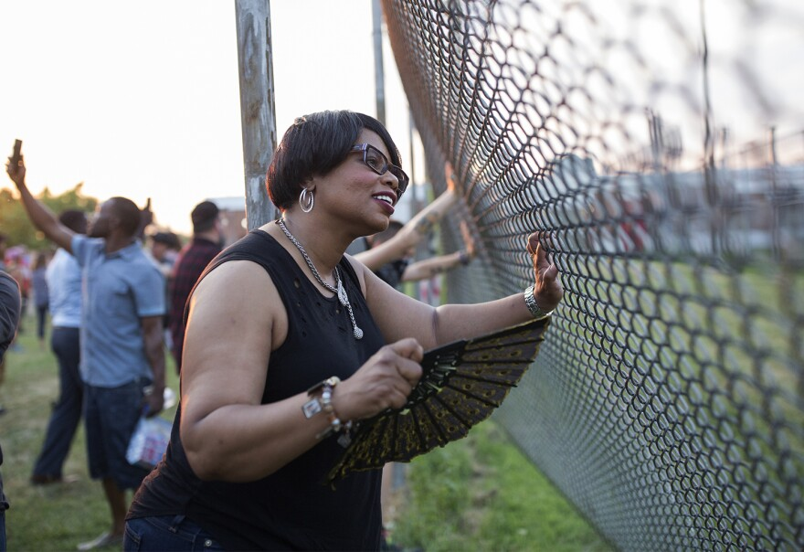 File: Protesters pushed fences outside the Medium Security Institution in St. Louis as temperatures reached into the triple digits over the summer. The men's side of the jail is not climate-controlled.