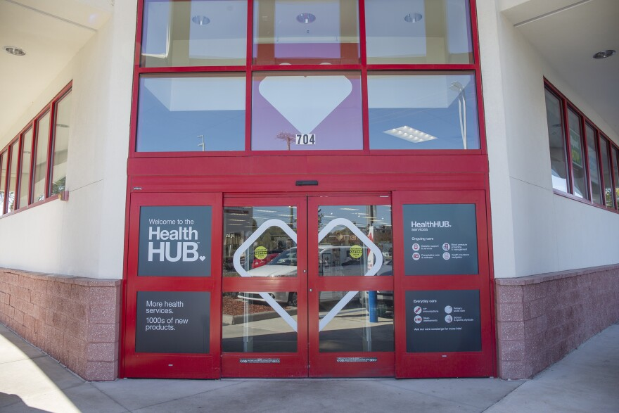 The electronic doors of a CVS HealthHUB with new signs.