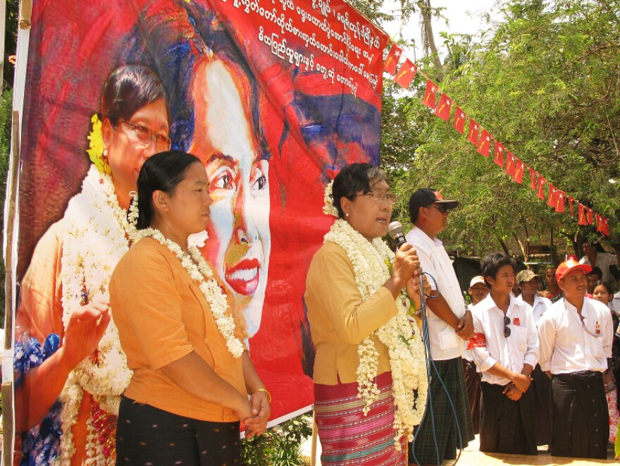 Dr. May Win Myint campaigns in front of a painting of Suu Kyi, leader of the National League of Democracy, at a rally near the capital Yangon. Win Myint has accused her opponent of vote-buying.