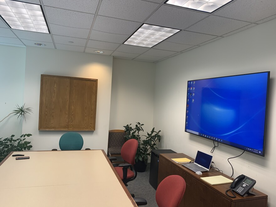 A Dec. 18, 2020 photo shows a conference room with a TV screen and computer that prosecutors use to conduct virtual court hearings.