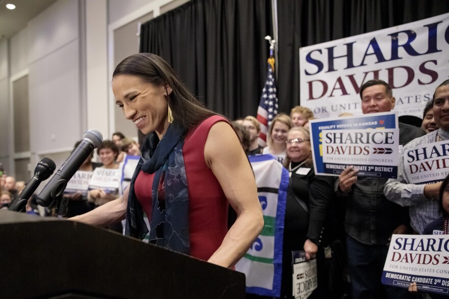 After winning Kansas' 3rd District, Sharice Davids is projected to become one of the first Native American women to serve in Congress and the first LGBTQ person to represent the state in the lawmaking body.