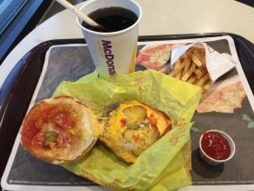 A McDonald's cheeseburger meal with a small Coke costs $3.88 and has 700 calories and 23 grams of fat (excluding the ketchup). Such restaurant food cannot be purchased with Supplemental Nutrition Assistance Program aid, though in some areas exceptions exist for the indigent, the elderly and the disabled.