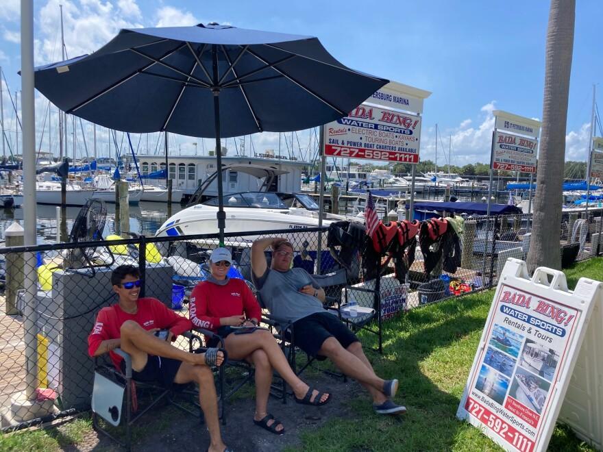 Employees idle outside the marina