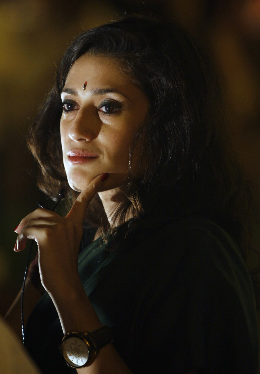 """Fatima Bhutto says it was """"totally terrifying"""" to go through airport security with her laptop full of research material for <em>The Runaways</em>. """"You know, 'I'm writing a novel' is kind of like 'my dog ate my homework,' I think, at an airport,"""" she says. Bhutto is pictured above in New Delhi in April 2010."""