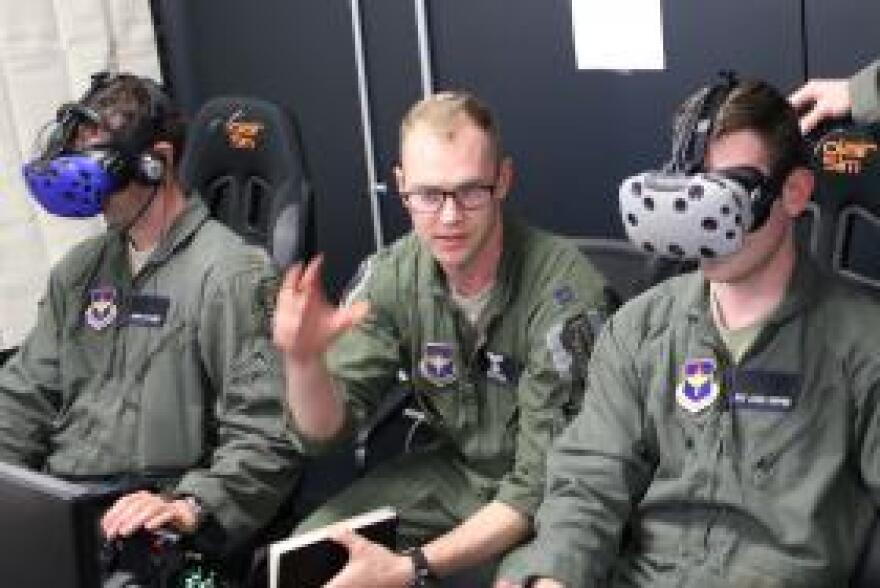 Instructor pilot Capt. Grizz Neal (right) oversees Lt. John Massey and Airman 1st Class Jack Pepper on the Pilot Training Next simulator.
