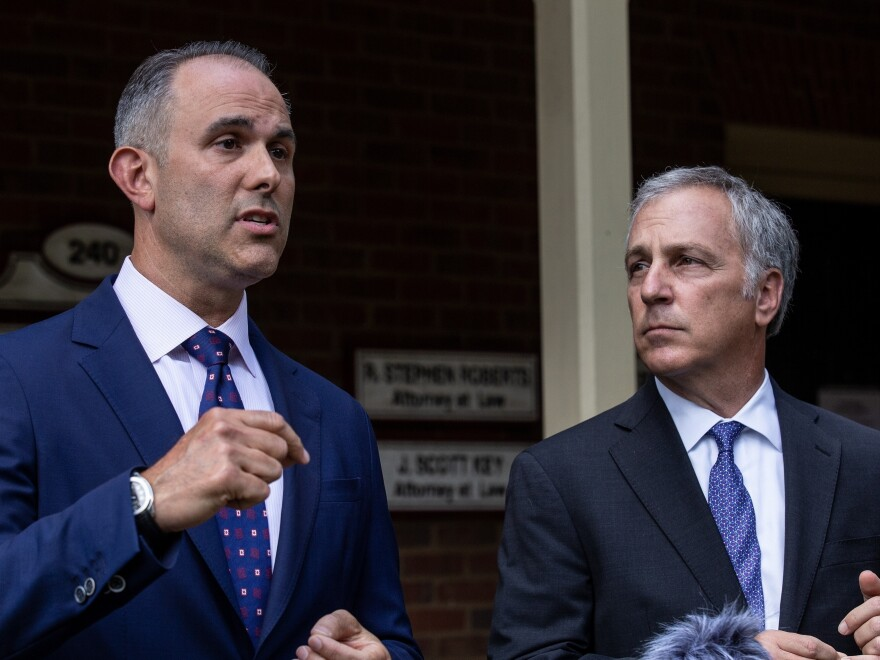 Attorney Jason Sheffield. left, and his law firm partner, Robert Rubin, respond to questions from the press outside their office on Thursday, in Decatur, Ga. The attorneys are representing Travis McMichael.