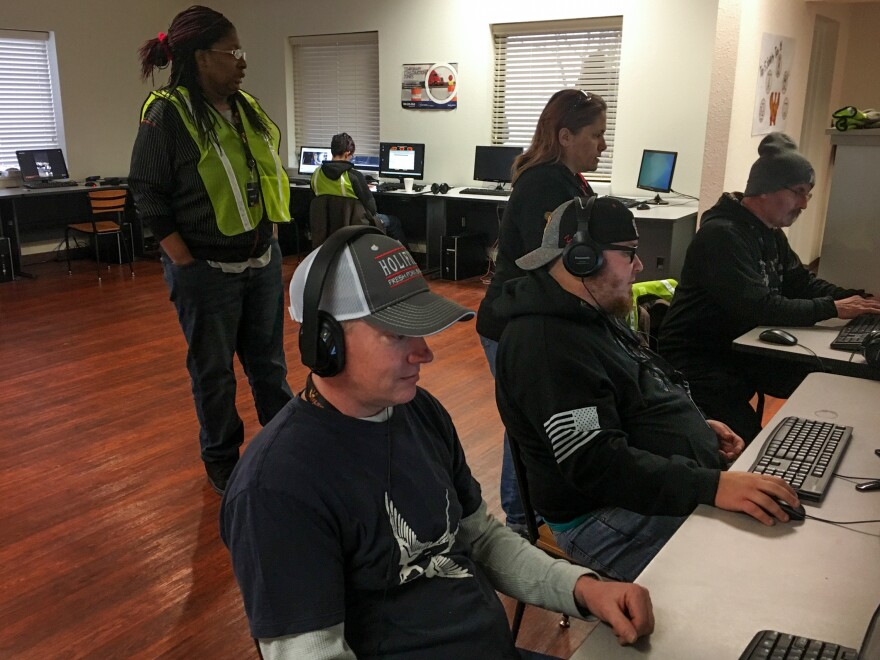 Truck driving trainees work in the classroom at Wilson Logistics driving school in Springfield, Mo. Despite pay hikes and greater inclusivity, there is still a critical shortage of long-haul truck drivers.