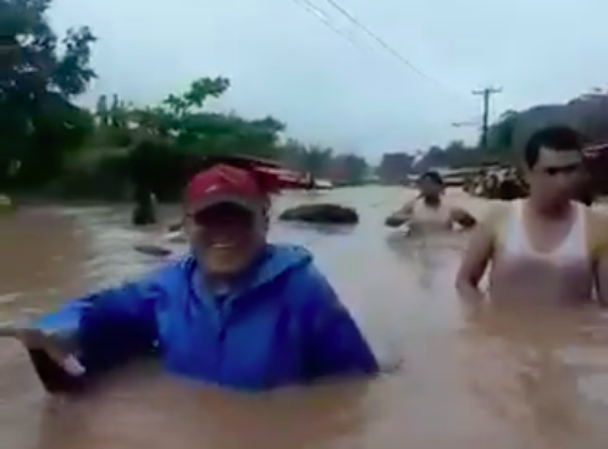 Residents of the northern Nicaraguan town of Siuna wade through their flooded streets after Hurricane Iota swept through this week.