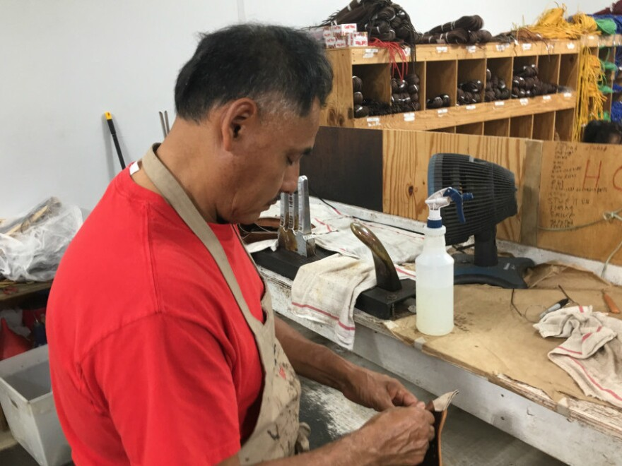 Martin Gomez has worked at Nokona for 19 years. He is considered a master at making these baseball gloves.