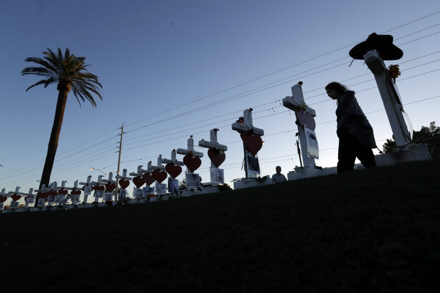 Manuela Barela passes crosses set up to honor those killed during the mass shooting Friday, Oct. 6, 2017, in Las Vegas. (Gregory Bull/AP)