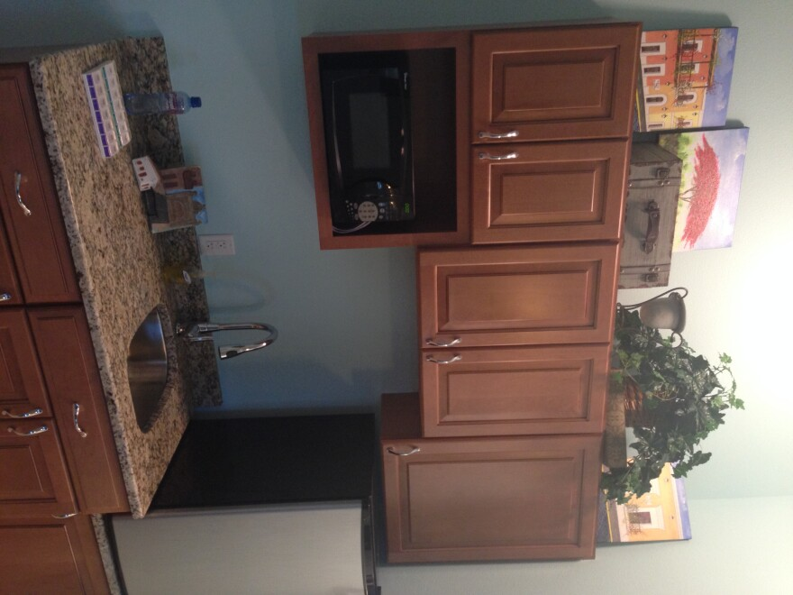 Barnett said the top cabinets in the kitchenette are for storage and not for everyday things.