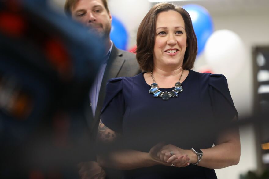 MJ Hegar speaks to supporters at the Riveter during an election watch party Tuesday. Unofficial results showed her leading the Democratic primary.