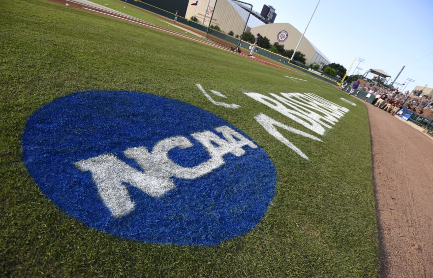 The NCAA logo is painted alongside the visitor dugout at Olsen Field before the start of a NCAA college baseball super regional tournament game between TCU and Texas A&M, Friday, June 10, 2016, in College Station, Texas.