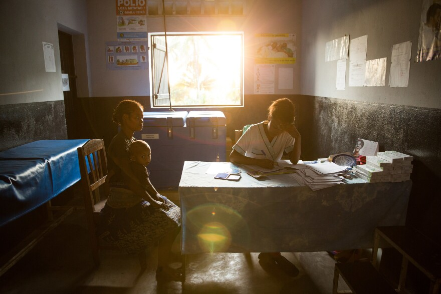 A 19-year-old woman talks with nurse Valeria Zafisoa at a traveling contraception clinic in eastern Madagascar run by the British nonprofit group Marie Stopes International.