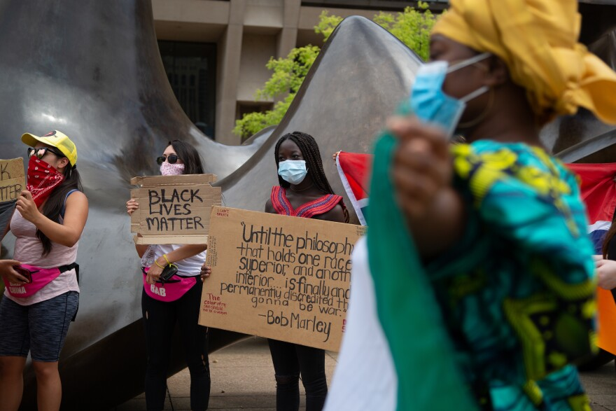 Black Lives Matter protesters demonstrate in front of Dallas City Hall on June 17, 2020.