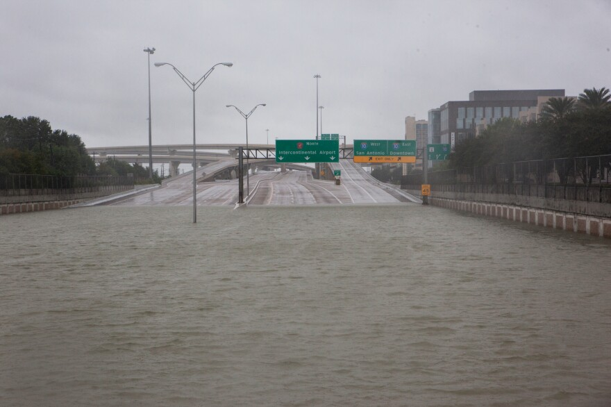 The Sam Houston Tollway is submerged near the Hedwig Village neighborhood in Houston on Tuesday.