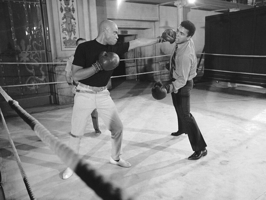 Muhammad Ali (right) takes on James Earl Jones in the ring. When this photo was captured in 1969, Jones was making the film <em>The Great White Hope</em> and Ali dropped by to help drum up publicity.
